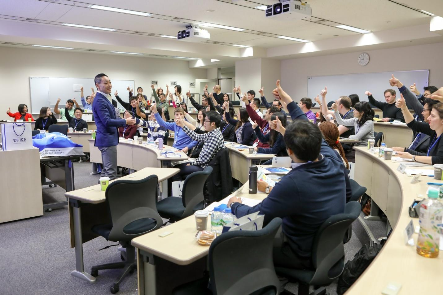 MBA students raising hands to answer