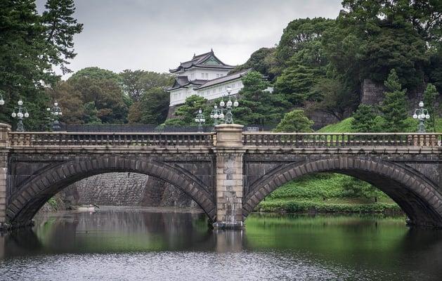 a bridge with a japanese castle